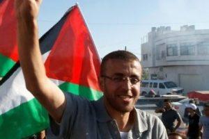العفو الدولية تطالب السلطات الإسرائيلية بالإفراج عن صحفي فلسطيني مضرب عن الطعام